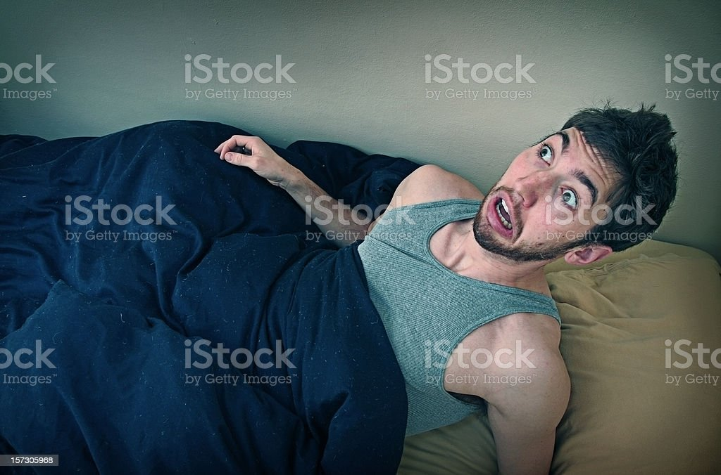 Young Man Wakes Up From Bad Dream stock photo