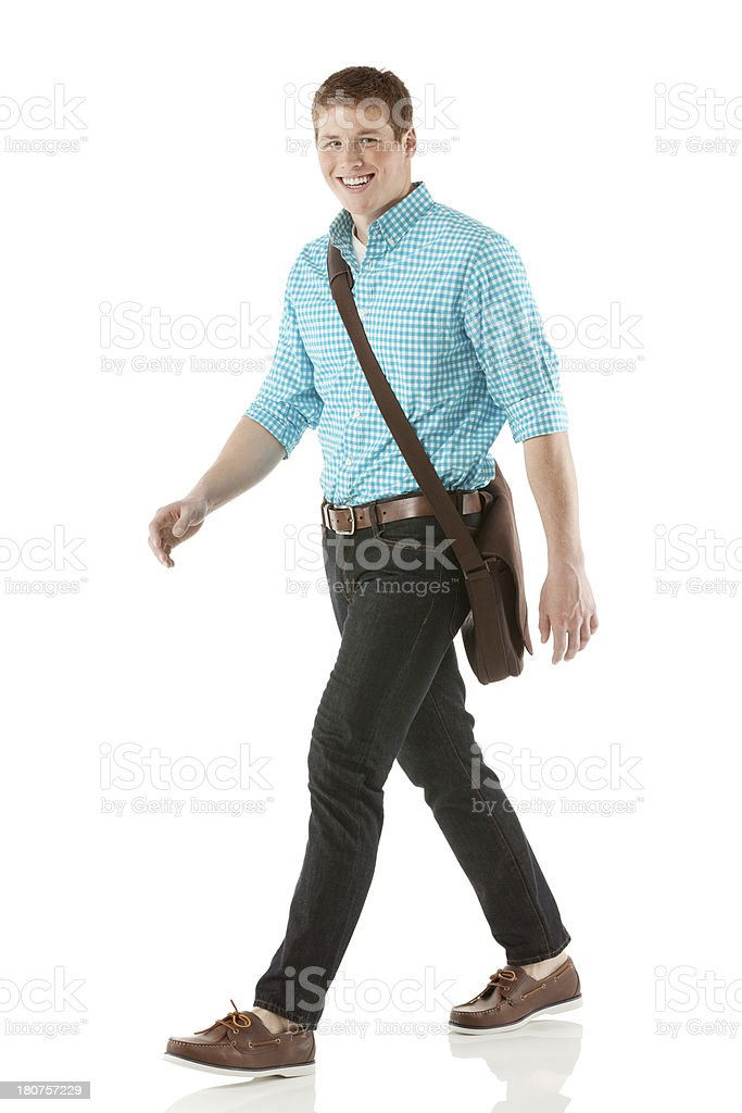 Young man walking in a white background royalty-free stock photo