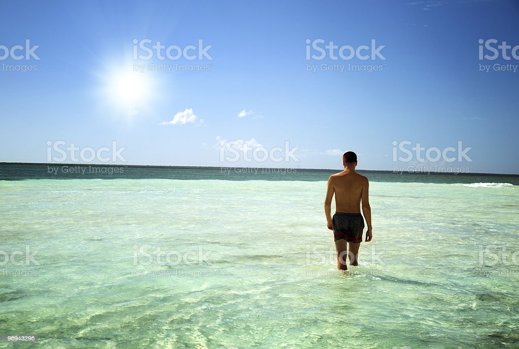 young man walking in Caribbean sea royalty-free stock photo