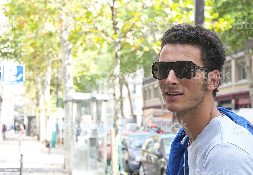 Young Man Walking in Paris, France stock photo