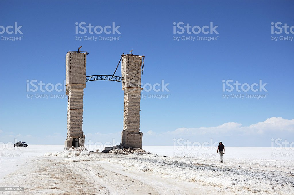 Young man walking in salt desert stock photo