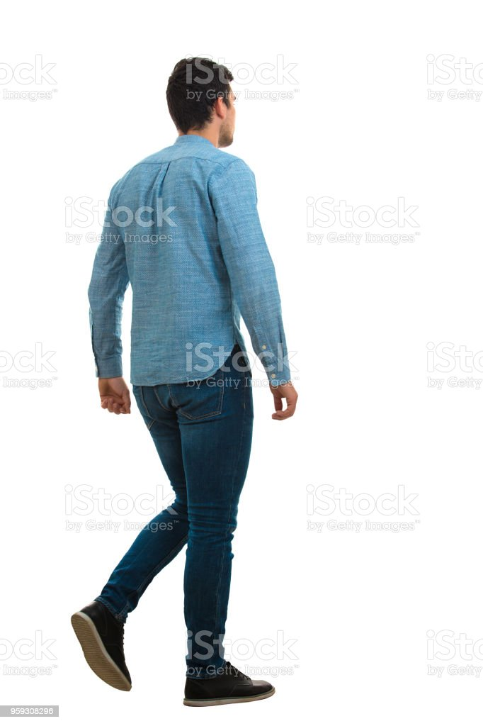 young man walking isolated on white background stock photo