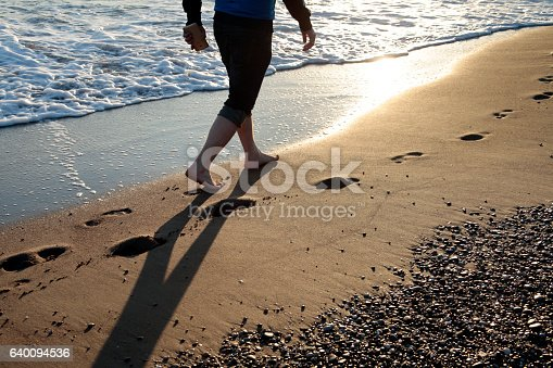 174919648 istock photo Young man walking on the beach 640094536
