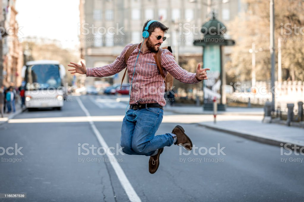 Handsome Man in Plaid Shirt and Sunglasses is Walking in the City...