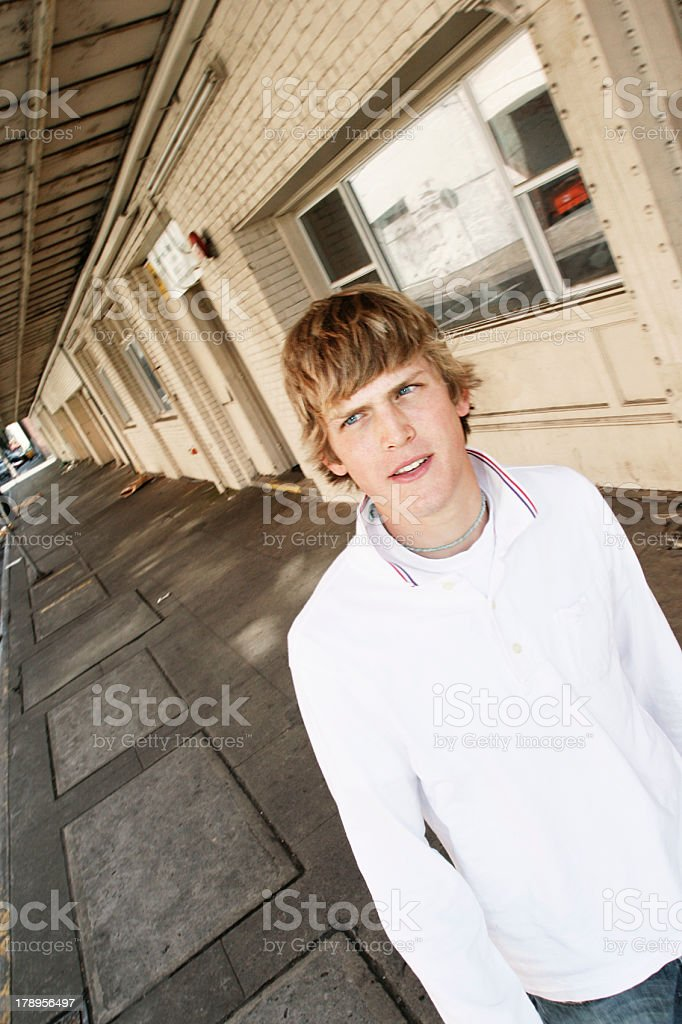 Young Man Walking Through a School royalty-free stock photo