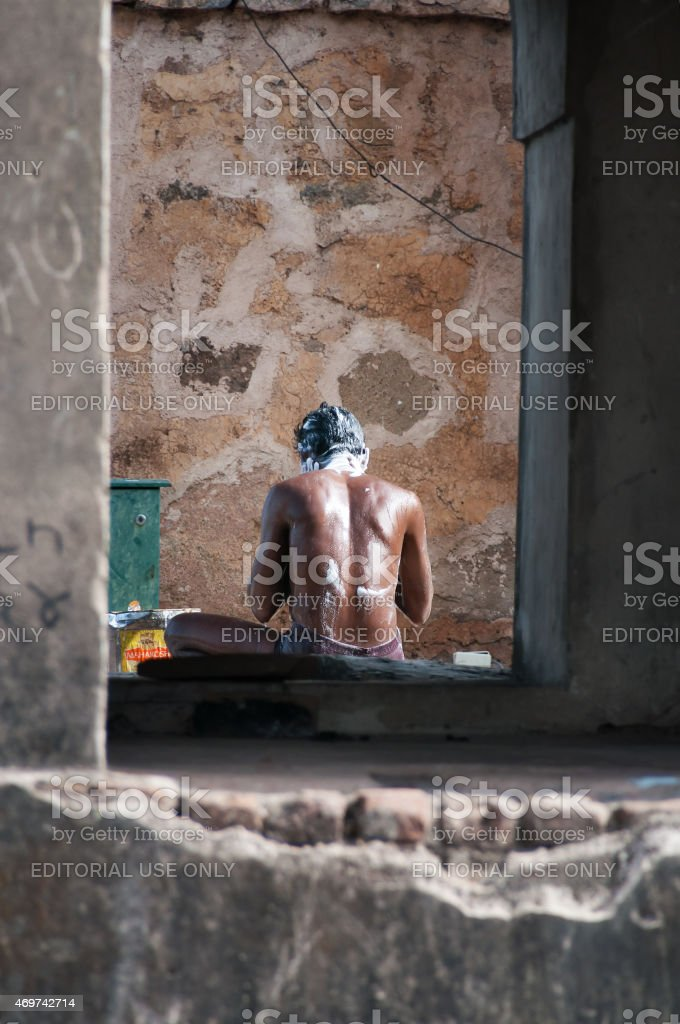 Young man washes himself in Orchha palace on the street stock photo