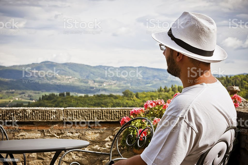Young Man Watching Landscape of the Chianti Region stock photo
