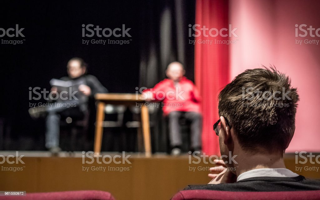 Young Man Watching Theatrical Performance.