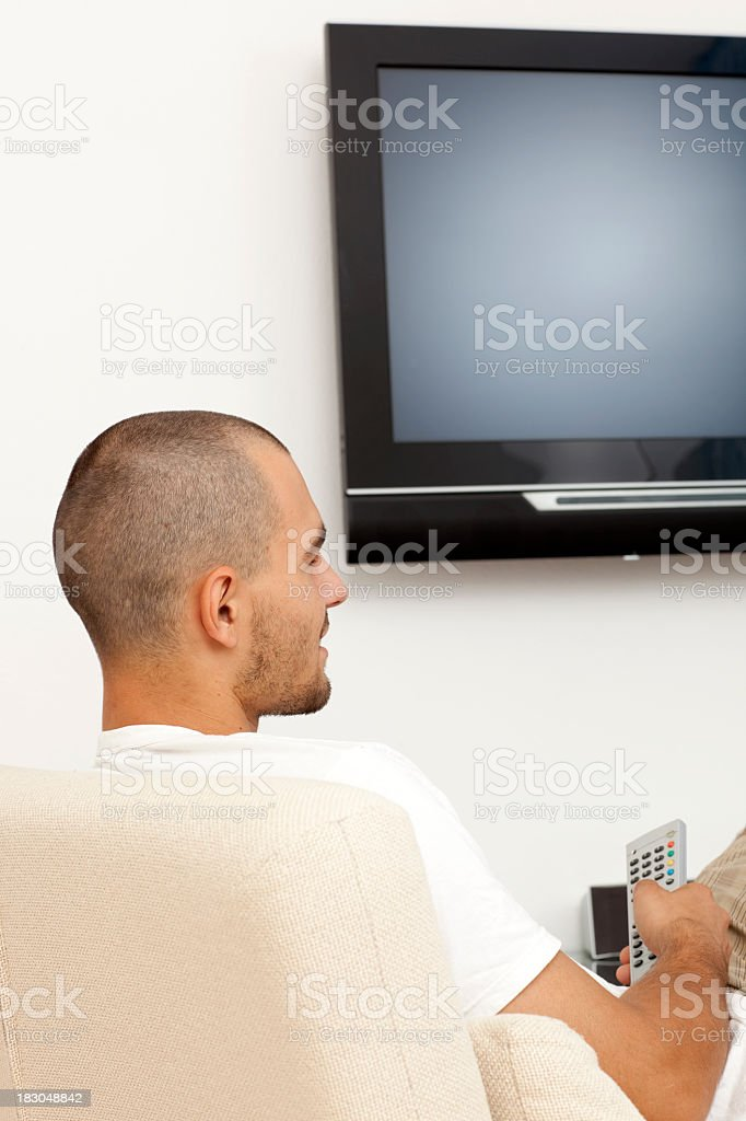 Young man watching TV. royalty-free stock photo