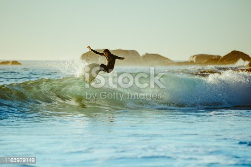 Young man water surfing in the sea. Male surfer in the ocean water with surf board.