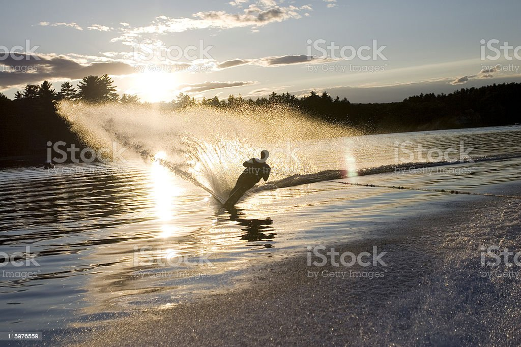 Young Man Waterskiing in New Hampshire in the Evening Sun stock photo
