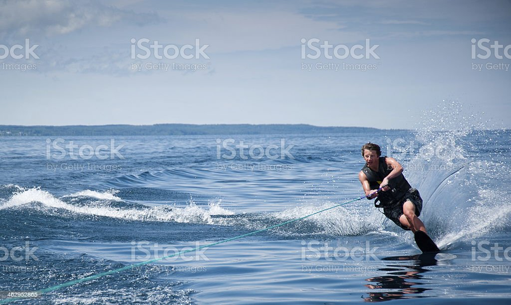 Young Man waterskiing with wake stock photo
