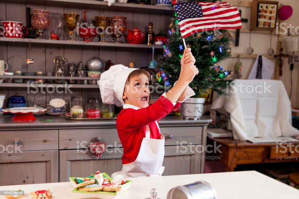 young man waving the american flag stock photo