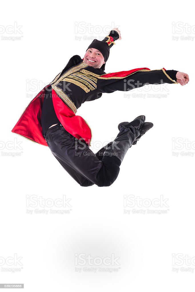young man wearing a folk costume jumping against isolated white royalty-free stock photo