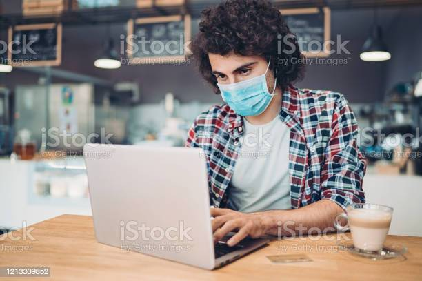 Young man wearing a protective mask typing on a laptop picture id1213309852?b=1&k=6&m=1213309852&s=612x612&h=et4n30pkmrehdep9asqqh lr6kq0rxfeqraearnfxim=