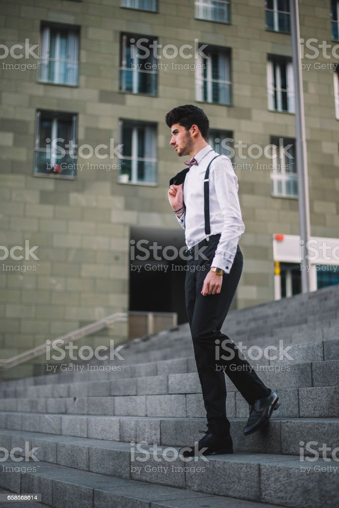 Young man wearing a suit stock photo