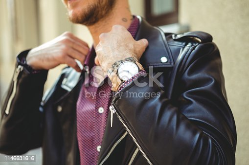 Young Man Wearing Analog Watch in the Urban environment with Tattoos