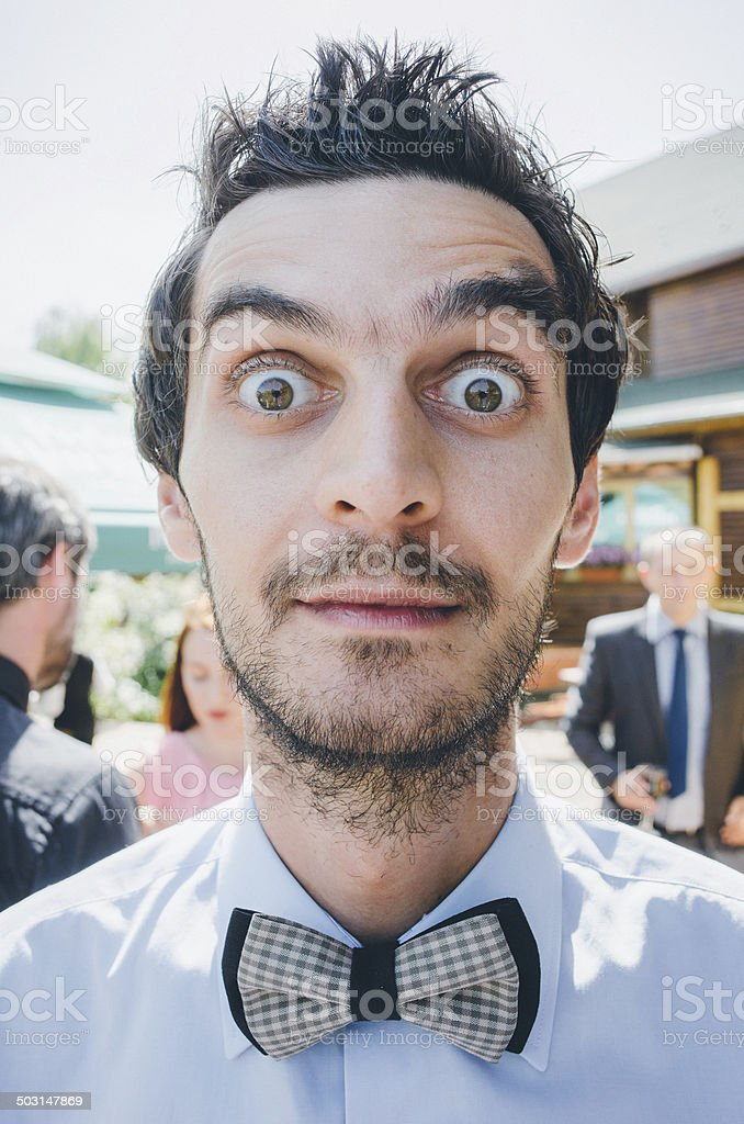 young man wearing bow tie and eyes whide open stock photo