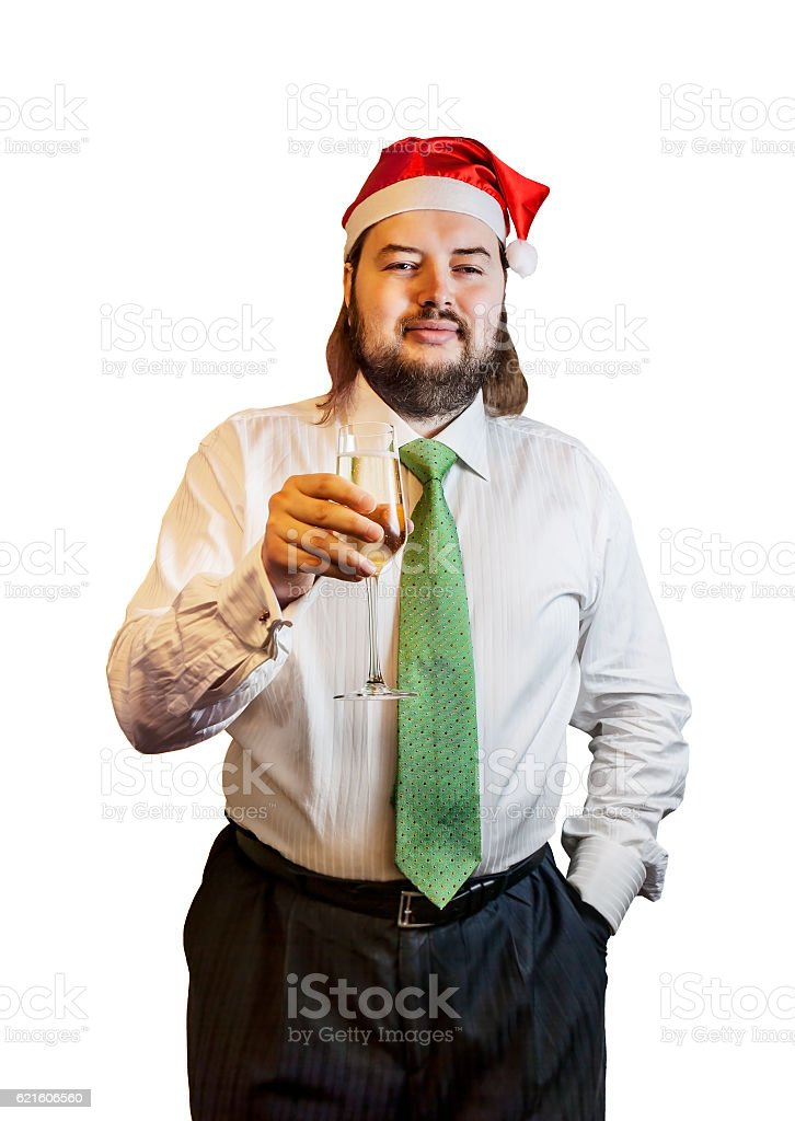 Young  man wearing Christmas hat with glass of champagne isolated stock photo