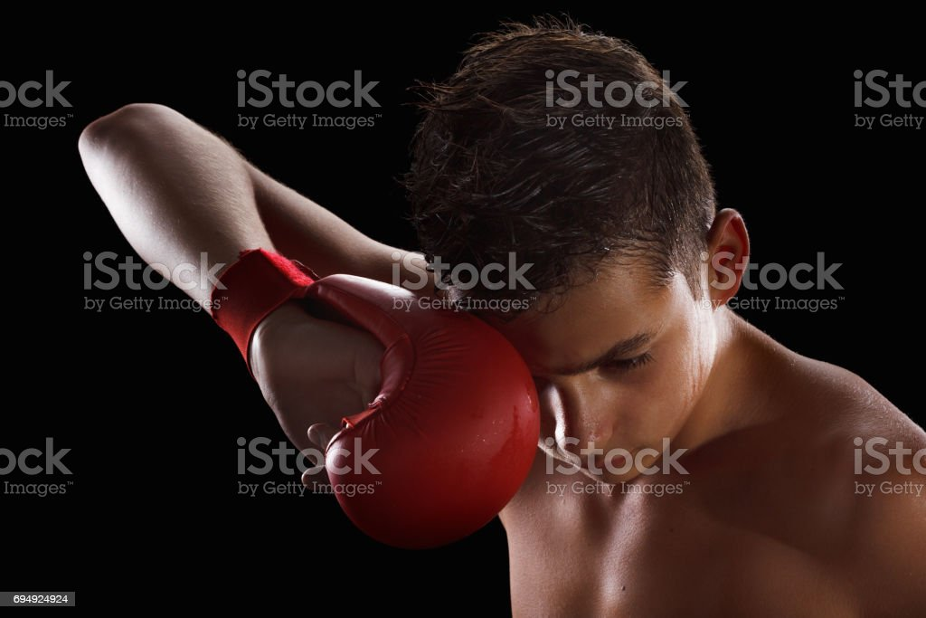 Young man wearing gloves, sports, karate or boxing, martial arts stock photo