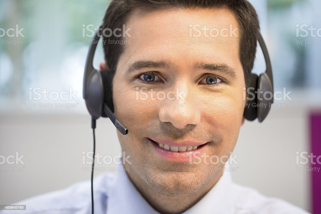 Young man wearing headset and smiling stock photo