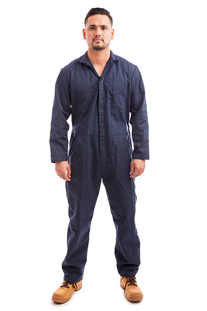 Young man wearing overalls Full length portrait of a young good looking man wearing overalls for work on a white background bib overalls stock pictures, royalty-free photos & images