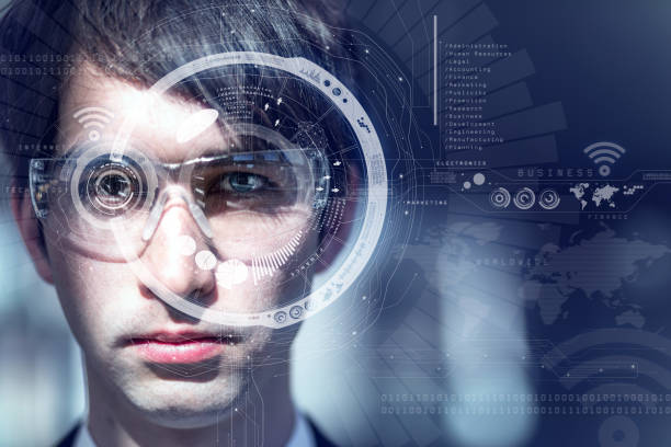 young man wearing smart glasses, heads up display, wearable computing, wearable device, internet of things, abstract image visual stock photo