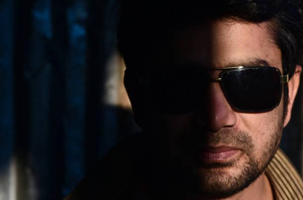 Young man wearing sunglass unique portraits photo stock photo