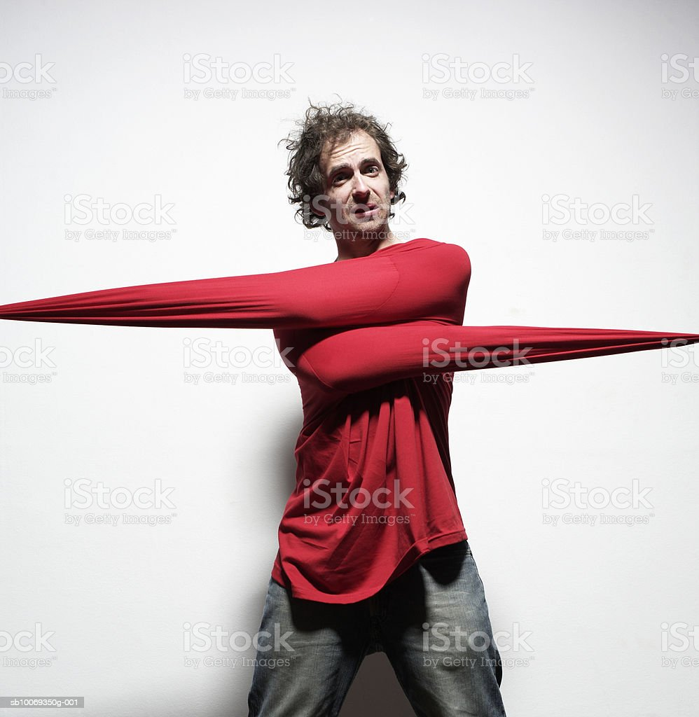 Young man wearing sweater with stretched arms, portrait royalty-free stock photo