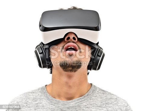 Young man wearing vr headset and handphones. Isolated on white. Wearable technology concept.