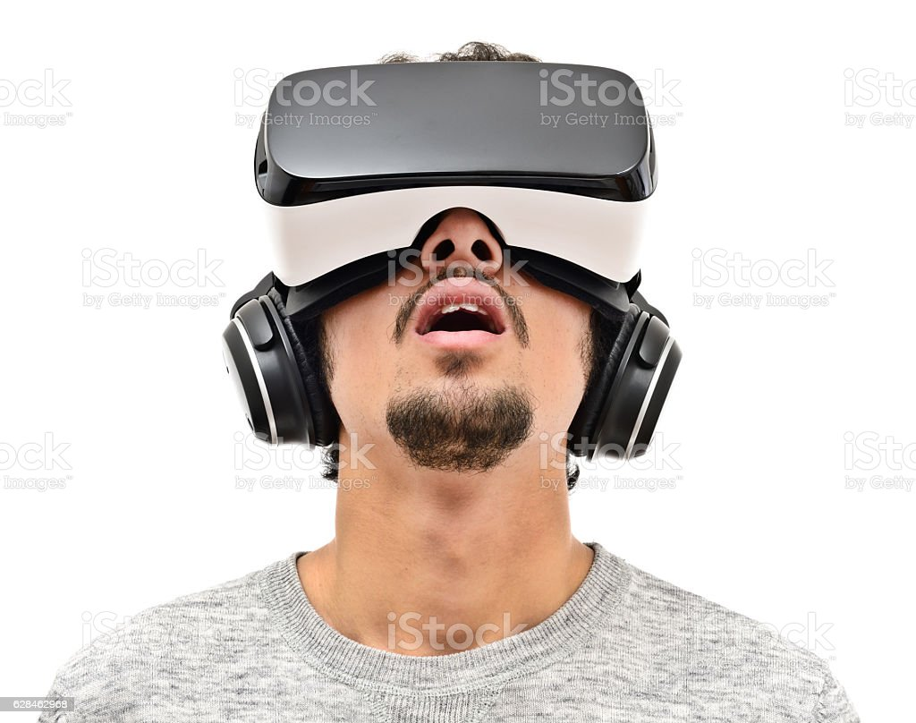 Young man wearing vr headset stock photo