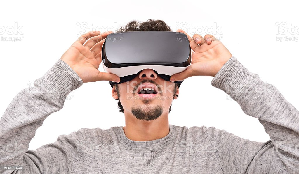 Young man wearing vr headset - Photo