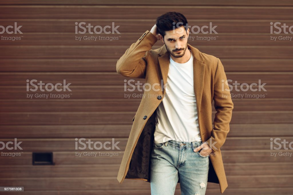 Young man wearing winter clothes in the street. stock photo