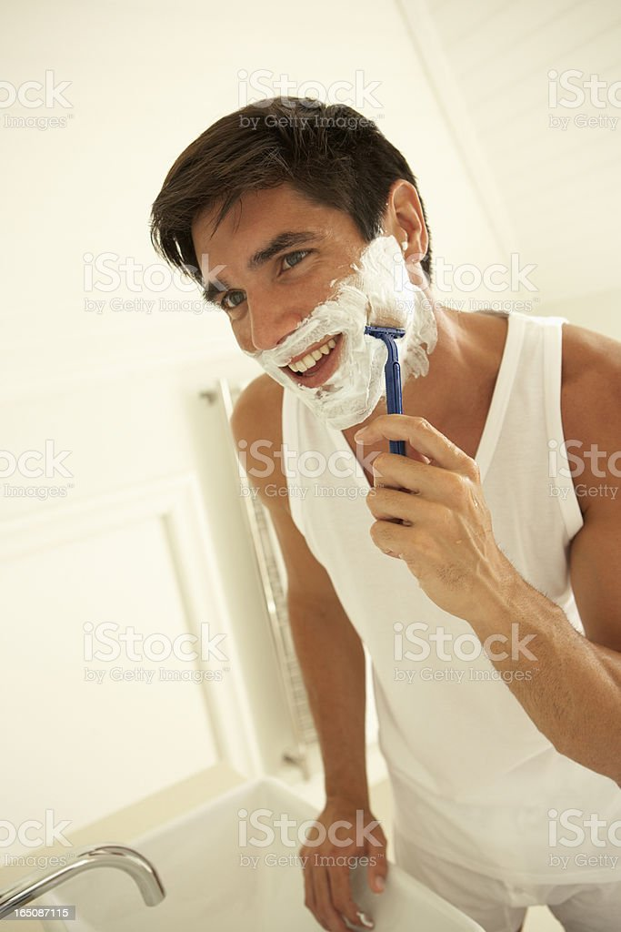 Young Man Wet Shaving With Razor royalty-free stock photo
