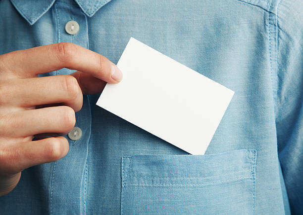 young man who takes out blank business card from the - business card stock photos and pictures