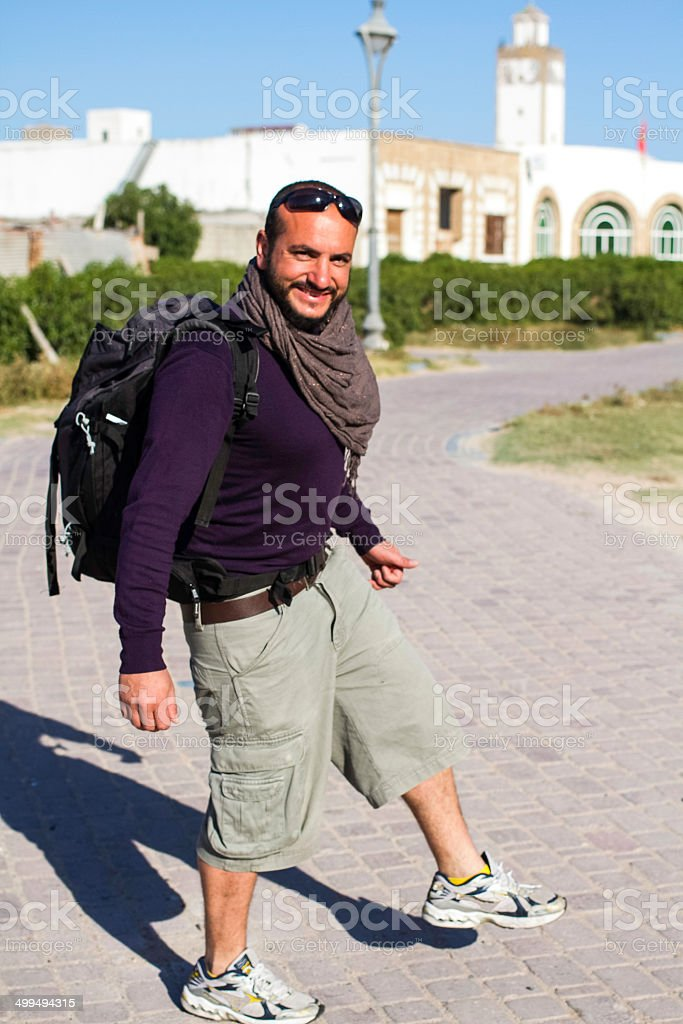 Young man with a backpack. Backpacker and traveller. stock photo