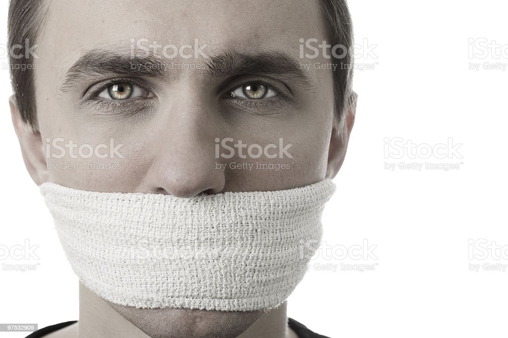 Young Man with a Bandage covering his Mouth royalty-free stock photo