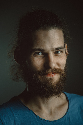 Young Man With A Beard And Long Curly Hair Stock Photo ...