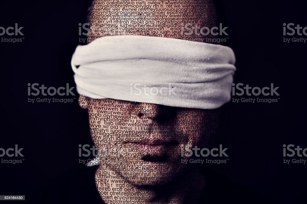 young man with a blindfold in his eyes stock photo