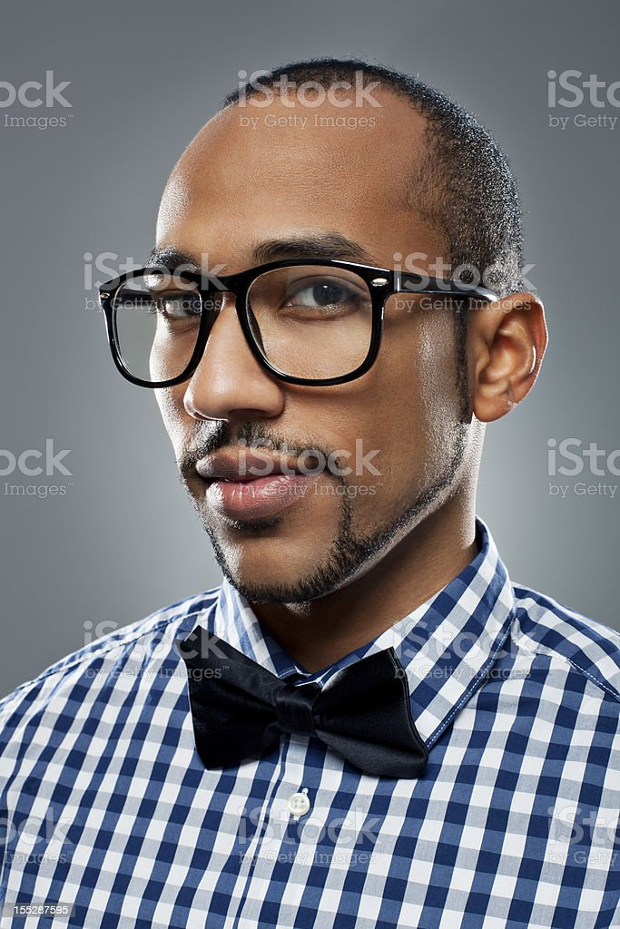 Young man with a  bow tie royalty-free stock photo