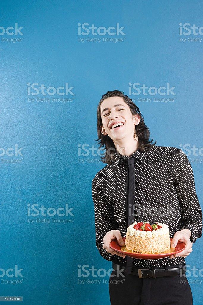 Jovem com um bolo foto de stock royalty-free