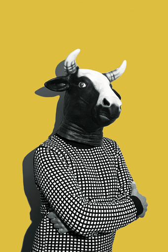 istock young man with a cow mask 1130464737