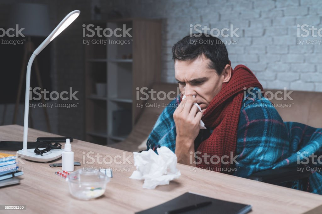 A young man with a disability got a cold. stock photo