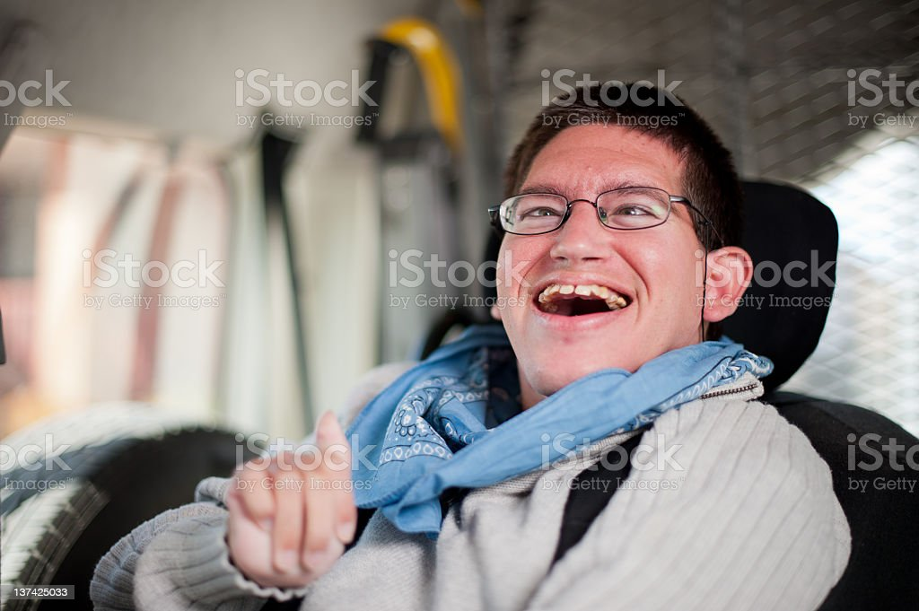 Young Man with a Disability in Taxi stock photo