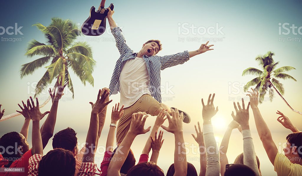 Young Man with a Guitar Performing on a Beach Concert stock photo