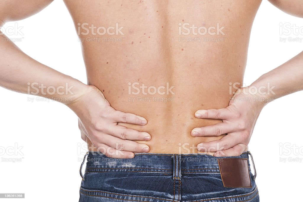 young man with a pain in  waist stock photo