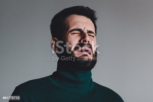 istock Young man with a problem crying 664775710