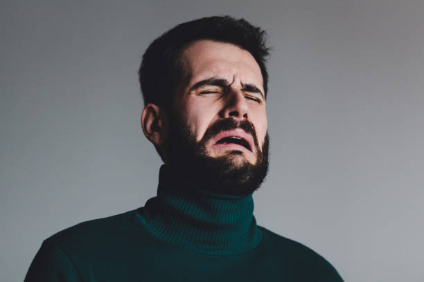 Young man with a problem crying stock photo