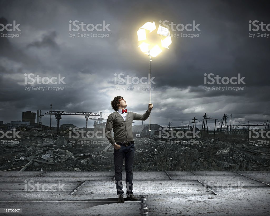 Young man with a recycle symbol royalty-free stock photo