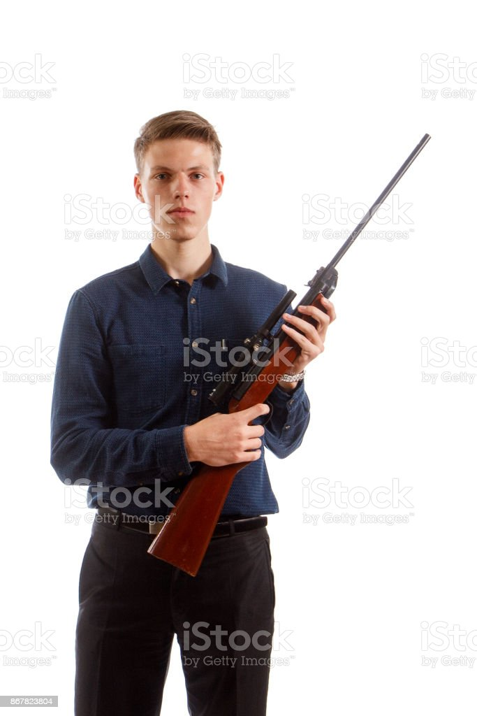 Young man with a rifle stock photo